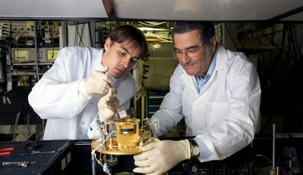 A 2009 photo provided by the CNRS shows French physician Serge Haroche, right, with his assistant.