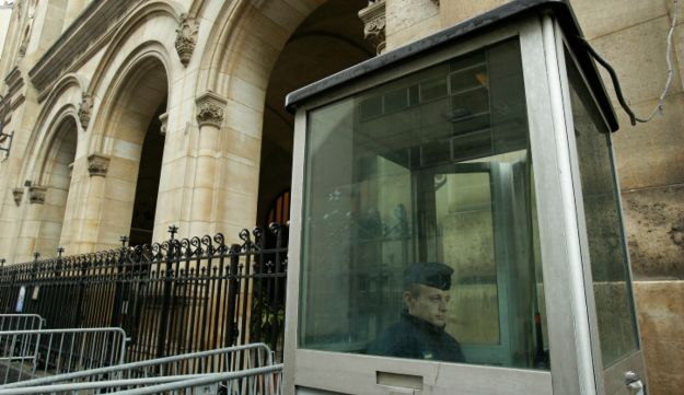 French police officer sitting in a guard post outside a synagogue - AP - 8.10.2012
