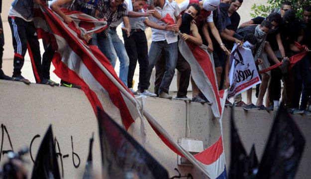 An American flag pulled down from the U.S. embassy in Cairo - Reuters - September 11, 2012.