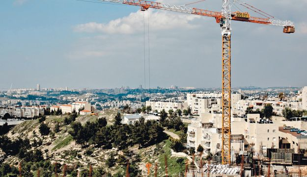 Jerusalem housing construction. A crane towers over a construction site in the capital.