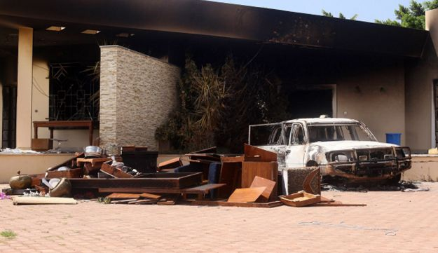 A burnt car is seen after an attack on the U.S. Consulate by protesters