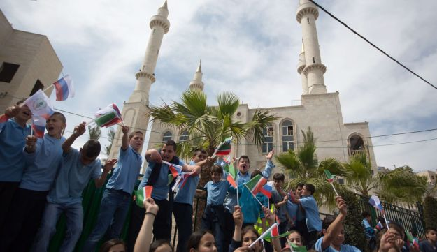 Residents of the Arab Israeli town of Abu Ghosh wave the Chechen flag