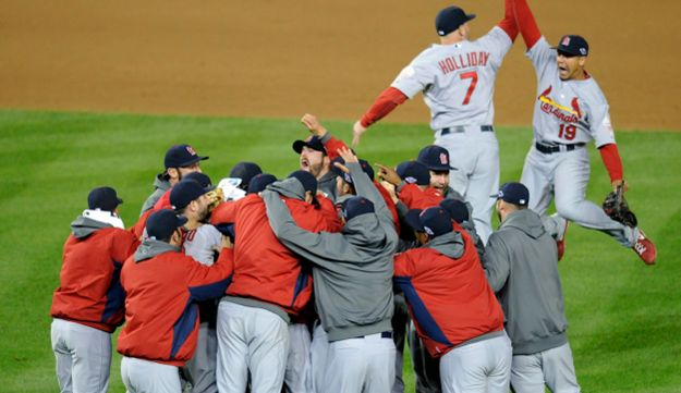 Members of the St. Louis Cardinals celebrate after Game 5 of the National League division