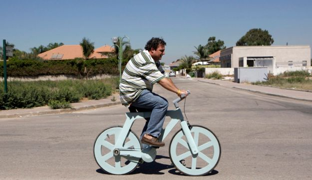 Israeli inventor Izhar Gafni rides his cardboard bicycle.
