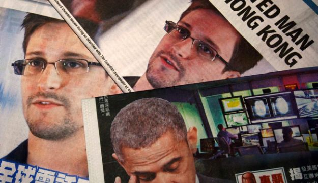 Photos of Edward Snowden, a contractor at the NSA, and U.S. President Barack Obama in newspapers