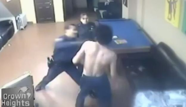 A screenshot of the security footage in which NYPD officiers attack a man at a Chabad youth center.