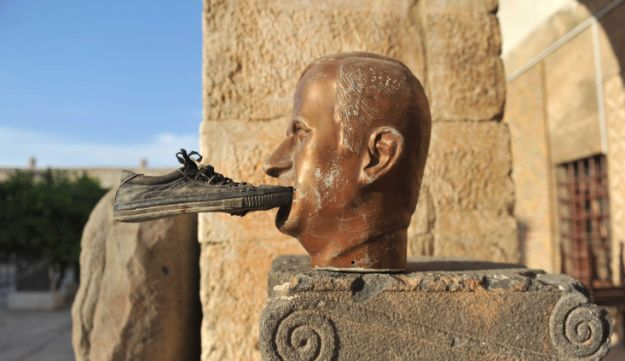 Shoe glued to statue of late Syrian president Hafez al-Assad - AFP