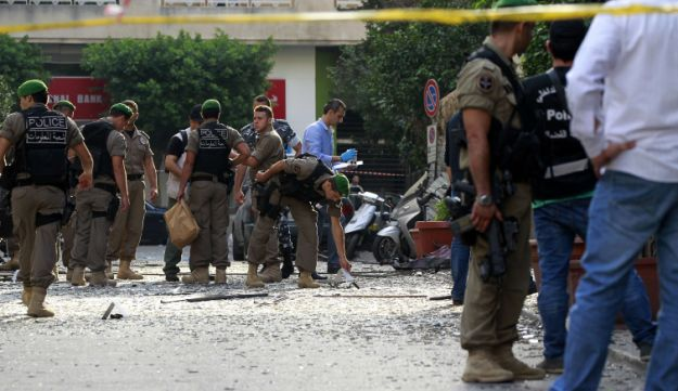 Lebanese security forces inspect damages in Beirut following bombing - AFP - October 20, 2012.