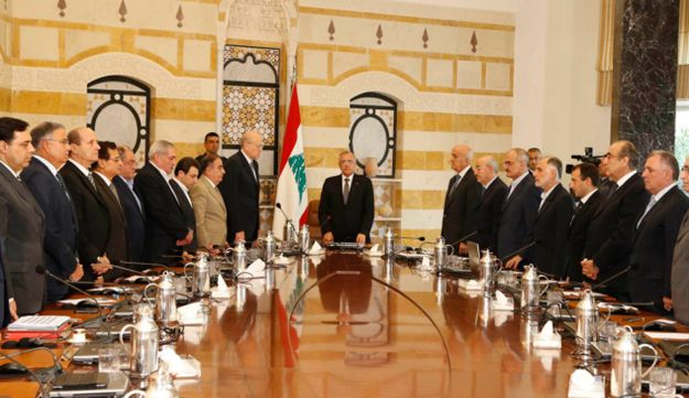 Lebanon's President Michel Suleiman observes a minute of silence with his Cabinet members