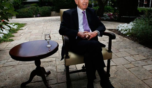 President Shimon Peres speaks during an interview with Reuters at his residence in Jerusalem