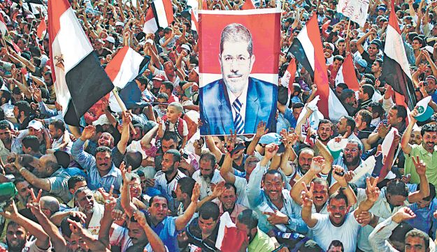 Supporters of Mohammed Morsi celebrate his election as president of Egypt