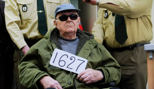Convicted Nazi death camp guard John Demjanjuk is brought to a courtroom in Munich.