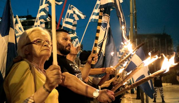 Members and supporters of the extreme right party Golden Dawn march in central Athens. May 29, 2013.