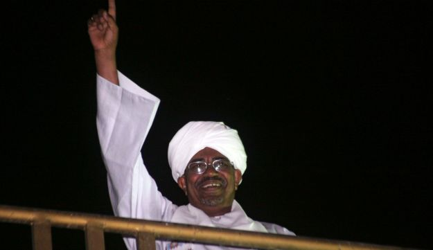 Sudanese President Omar al-Bashir gestures to anti-Israel protesters, Oct. 24.
