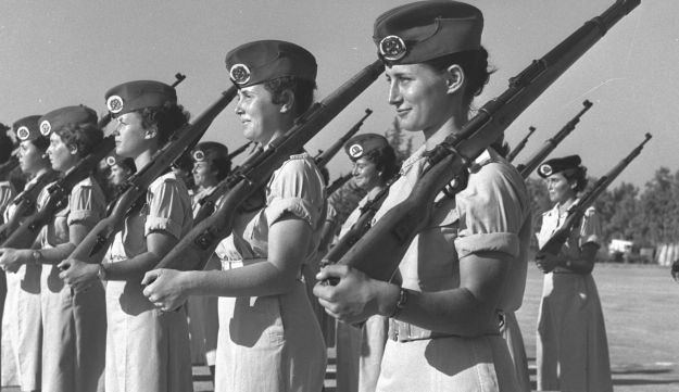 Women graduates of an Israel defence forces, officers course. first on right Yael Dayan.