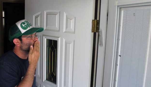 Jake Matilsky kisses a new mezuzah installed at his home in Helena, Mont., June 30, 2013.