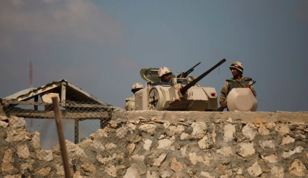 Egyptian army soldiers stand guard on the border with Egypt in Rafah