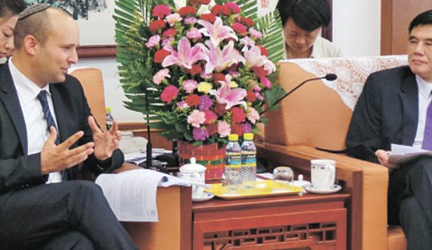 Bennett with China's National Development and Reform Commission chairman Zhang Ping.