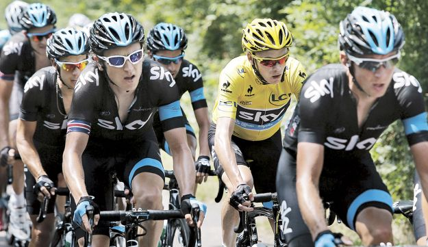 Chris Froome, second right, riding with his teammates on July 13, 2013.