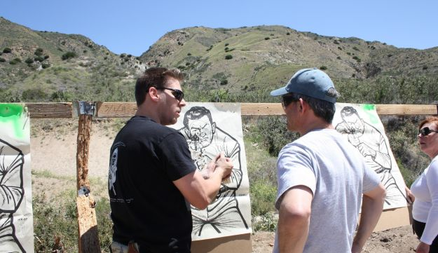 Itamar Gelbman and Sam Shink inspect the target during a shooting lesson.