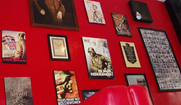 Nazi-related memorabilia hanging on a wall at Soldatenkaffe restaurant in Bandung,  Indonenisa.