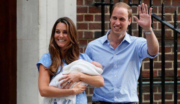 Britain's Prince William and his wife Catherine, Duchess of Cambridge appear with their baby son