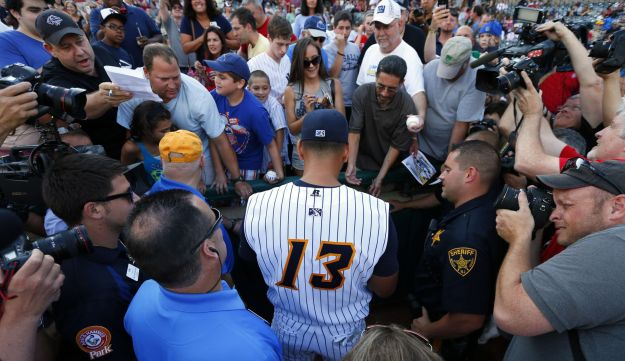 Alex Rodriguez signing autographs before his start in a rehab game on Friday August 2, 2013.