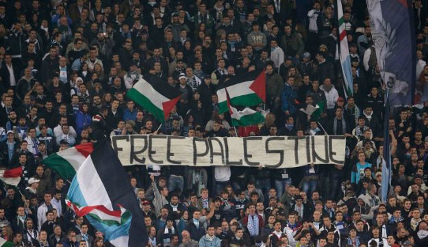SS Lazio's fans display a banner that reads, 'Free Palestine' during the Europa League soccer match