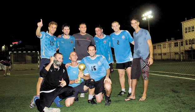 The victorious Uruguayans with their trophy.