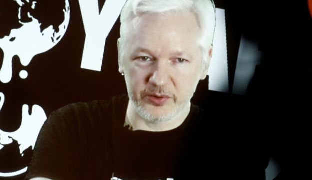 Julian Assange, founder and editor-in-chief of WikiLeaks speaks via video link during a press conference in Berlin, Germany, October 4, 2016.