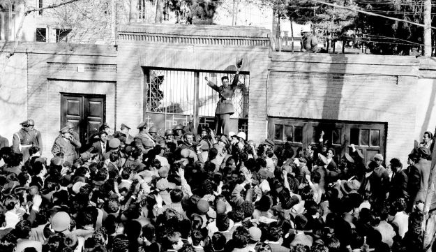 File photo:  An army officer rallies a crowd of supporters of Shah Mohammed Reza Pahlevi in front of the home of Iranian Prime Minister Mohammed Mossadegh in Tehran. Feb. 28, 1953.