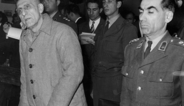 File photo: Former Iranian PM Mohammed Mosaddegh, left, is sentenced to three years solitary confinement by a military court after finding him guilty on 13 charges of acting against the Shah, in Tehran, Iran. Dec. 21, 1953.