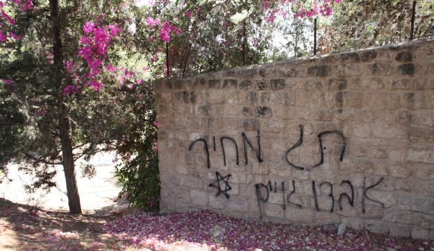 Graffiti on Beit Jamal monastery, reads 'price tag' and 'death to Gentiles'