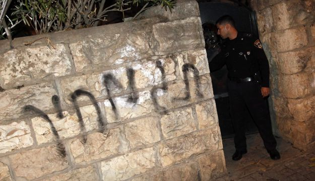 "Archive image of the words ""price tag"" daubed on a wall in Jerusalem."