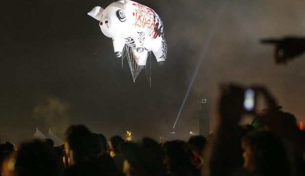 Pig-shaped balloon is seen in the sky as Roger Waters performs at the Coachella Music Festival.