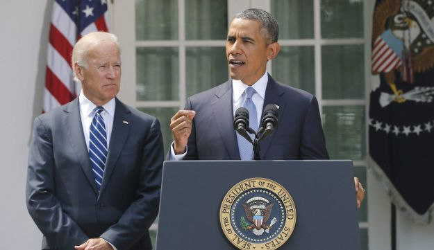 U.S. President Barack Obama stands with Vice President Joe Biden as he makes a statement about Syria