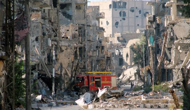 A firetruck left amid heavily damaged buildings in Syria's eastern town of Deir Ezzor. September 10,