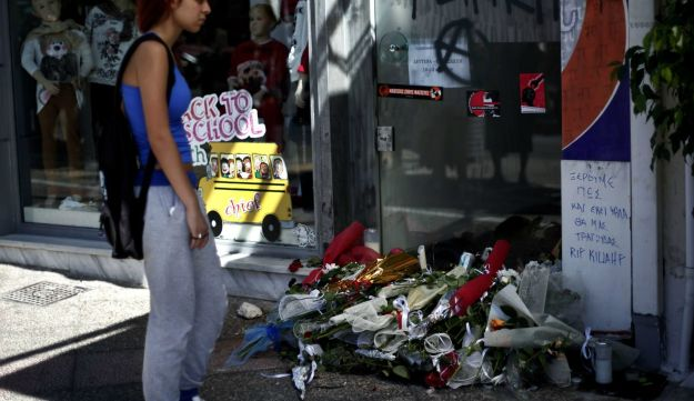 A woman stands on September 19, 2103 in front of the spot where was murdered Pavlos Fyssas.