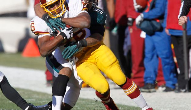 Washington Redskins' Alfred Morris is tackled after a gain