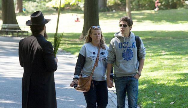 Yisroel Pekar approaches unsuspecting New Yorkers in Central Park.