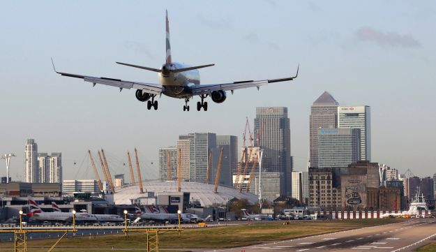 A British Airways aircraft lands at City Airport in London.