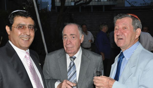 Albert Attias, left, and Charles Zslapak, right, elebrate centennial of Nairobi Hebrew Congregation