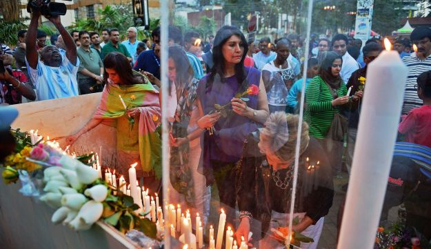 People gather for a 24-hour prayer vigil for the victims of the Westgate Mall massacre near the mall
