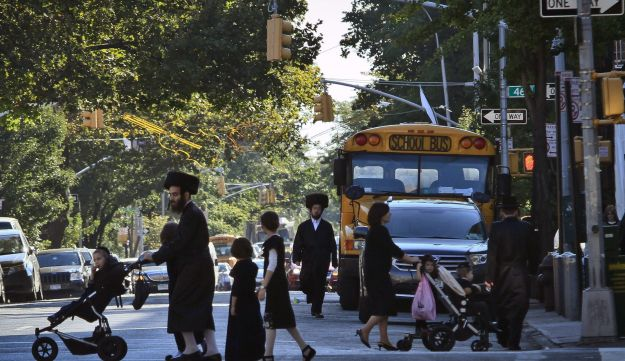 Ultra-Orthodox families in Brooklyn, New York, September 2013.