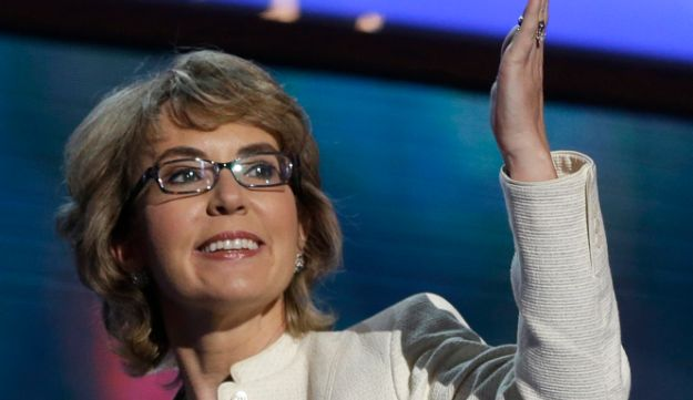 Former Arizona Rep. Gabrielle Giffords blows a kiss after reciting the Pledge of Allegiance