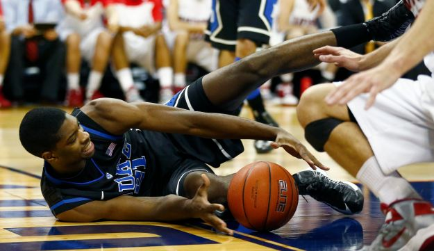 Duke Blue Devils forward Amile Jefferson works to control a loose ball.