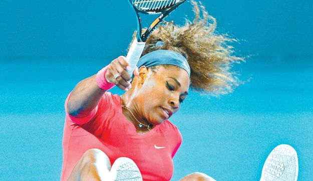 DOWN BUT NOT OUT: Serena Williams taking a tumble during the final of the Brisbane International.