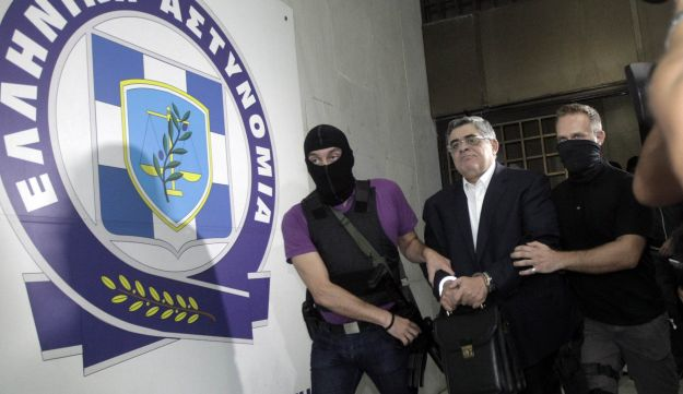 Far-right Golden Dawn party leader Nikolaos Mihaloliakos is escorted by anti-terrorism police