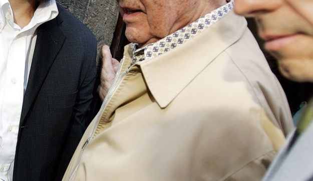 Priebke, center, leaves the office of his lawyer in 2007.