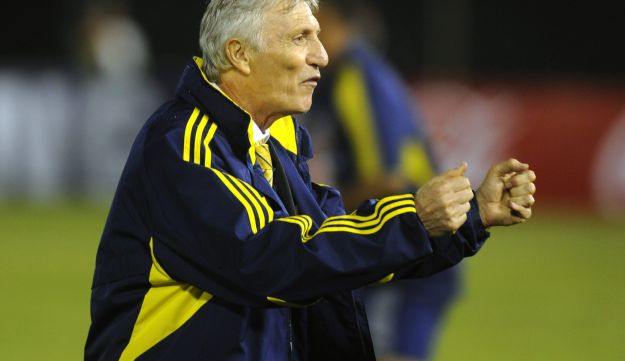 Colombia's coach Jose Pekerman celebrates after defeating Paraguay in their 2014 World Cup